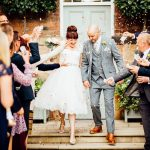 West mill Derby wedding bride and groom walking through confetti