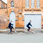 Fazeley Studios wedding groom, best man and ushers cycling in front of wedding venue