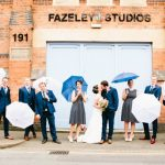 Bride and Groom standing outside Fazeley Studios - Wedding Photograph by John Charlton Photography
