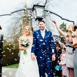 Moreton-in-the-Marsh spring wedding bride and groom walking through confetti