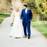 Moreton-in-the-Marsh spring wedding bride and groom walking hand in hand