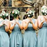 Moreton-in-the-Marsh wedding bridesmaids holding bouquets in front of their faces