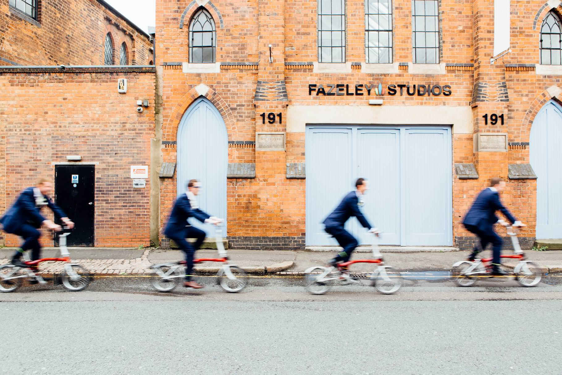 Fazeley studios wedding with groom and ushers riding Brompton bicycles